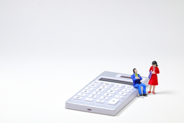 電卓と経営者